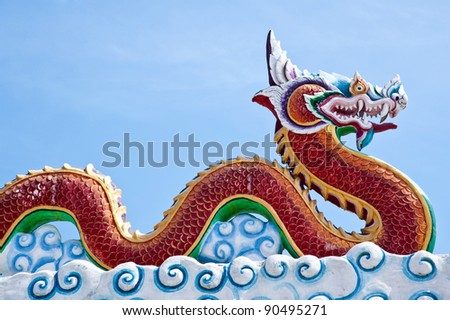 king of naga on thai temple roof - stock photo