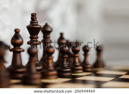 king, pawn and other figures on a chess board