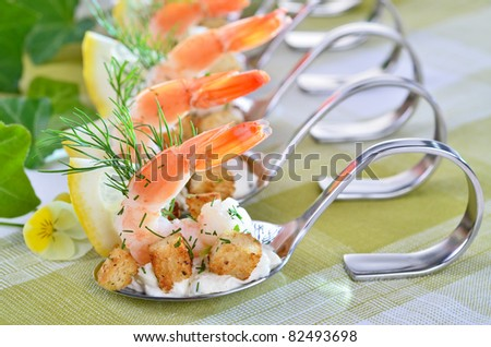 King Prawns with cream cheese and croutons on spoon