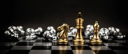 King Queen and knight chess team standing on chess board with chess that falling in the back concepts of business team and leadership strategy and organization risk management.