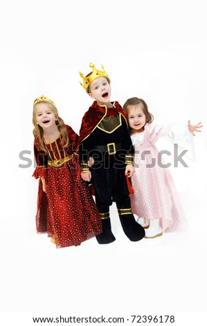 King, queen and princess are laughing and talking as they pose in their Halloween costumes.  Children are wearing crowns, gowns and royal cape.