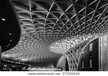 King's Cross London railway station indoor modern architecture construction, contrast with the old house #375250618