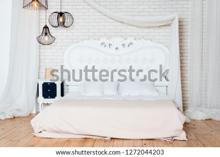 King size bed in loft apartment. Loft style bedroom with white design