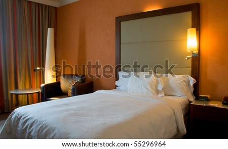 King-size bed with bedside table curtain and lamps