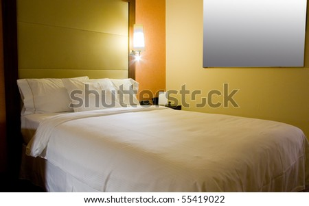 King-size bed with bedside table picture and lamps