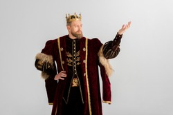 king with crown pointing with hand isolated on grey