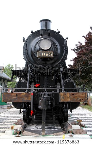 KINGSTON, CANADA - SEPTEMBER 7, 2012: An old locomotive on September 7, 2012 in Kingston. The locomotive, called Spirit of Sir John A., was in active service until 1960 and later became a landmark.