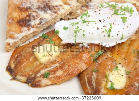 Kippers with poached egg and toast