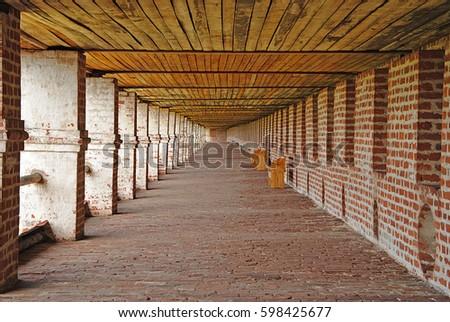 KIRILLOV, RUSSIA - JULY, 2011: corridor monastery wall of old red bricks