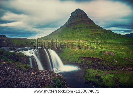 Kirkjufell mountain and waterfalls in Iceland, travel natural background