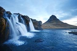 Kirkjufell mountain with waterfall cascades in iceland