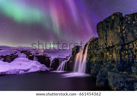 Kirkjufellsfoss waterfall under the northern lights #661454362
