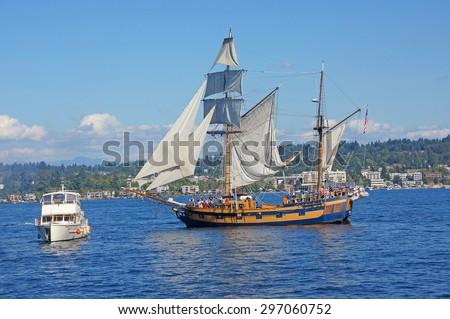 KIRKLAND, WASHINGTON - SEP 12, 2012 - The wooden hermaphrodite brig, Hawaiian Chieftain, sails on Lake Washington    during a mock sea battle as part of Labor Day festivities near Kirkland Washington.