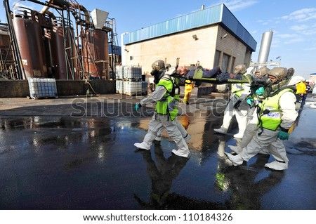 KIRYAT MALAKI, ISR - DECEMBER 2: The Israeli emergency forces held an exercise with a scenario that prepared for a possible rocket attack on a chemical factory on Dec 2 2009 in Kiryat Malaki, Israel.