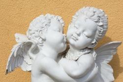 Kissing  angels garden ansient sculpture macro object