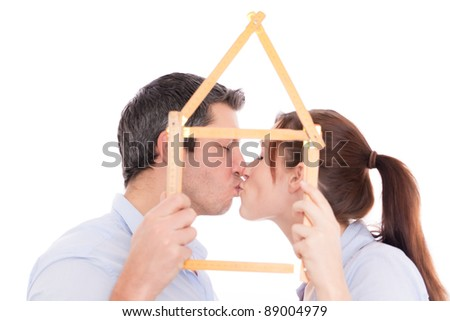 kissing couple after new home