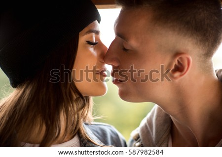 Kissing couple, close-up portrait of man and woman. Kiss, love and relationship of boy and girl