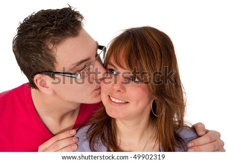 Kissing couple in portrait in the studio