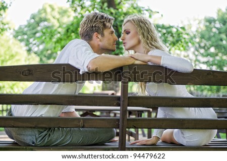 Kissing couple on the bench
