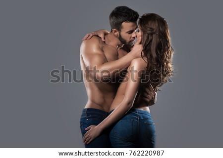 Kissing sexy couple in embrace