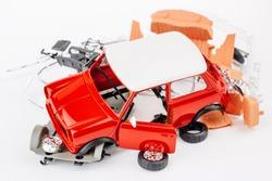 kit for assembling gray plastic car model on white background