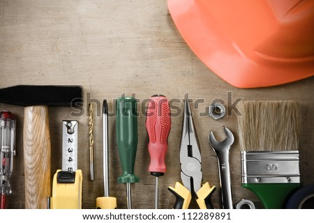 kit of construction tools and instruments on wood texture background