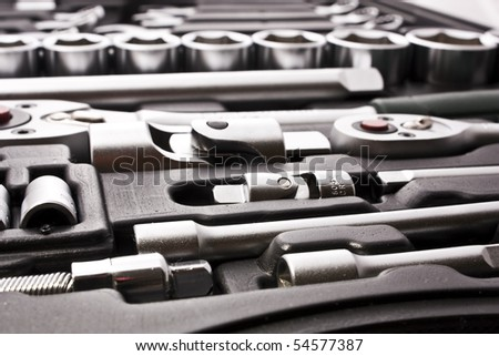 kit of metallic tools as background