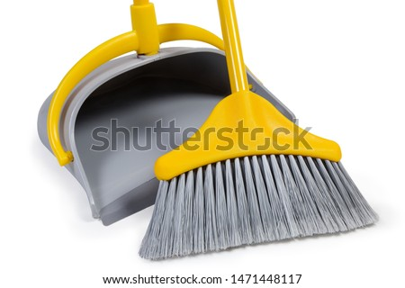 Kit of the yellow plastic broom with gray bristles for sweeping floors and dustpan on a white background, working parts close-up ストックフォト ©