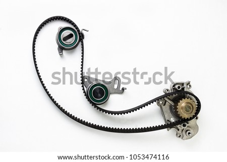 Kit of timing belt with rollers on a white background isolated. Auto Parts. Spare parts for the repair of cars. #1053474116