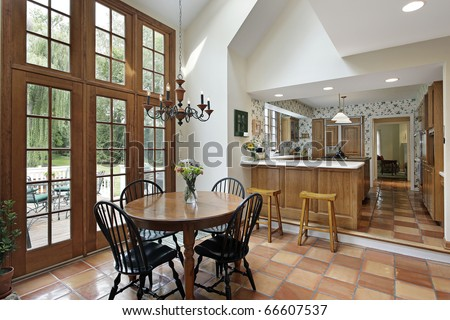 Kitchen and eating area with spanish tile