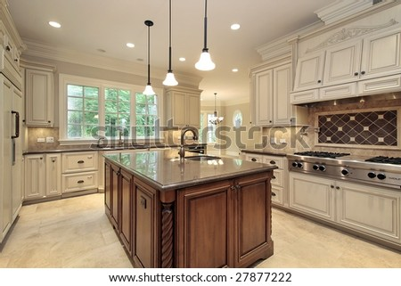 Kitchen and island in luxury home