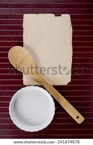 Kitchen background with wooden kitchen spatula. Kitchen equipment.