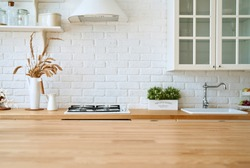 Kitchen blured background interior with wooden table.