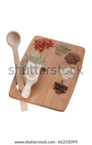 Kitchen board as an art palette for paints with spices and spoons.