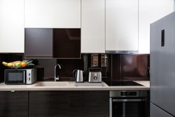 Kitchen cabinets and utensils, modern furnished contemporary kitchenette