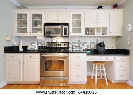 Kitchen cabinets n a modern home living room.