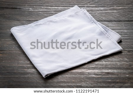kitchen cloth (napkin) on wood background - vintage effect filter