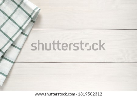 kitchen cloth on side of white wooden table, top view, copy space Stockfoto ©
