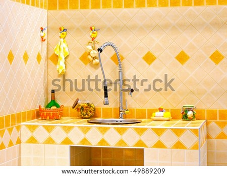 Kitchen counter and sink with orange tiles