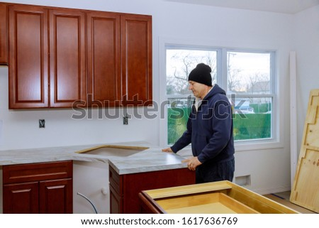 Kitchen counter top in a kitchen carpenter installing cabinets more functional with kitchen counter top