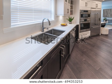 Kitchen counter with the sink. Interior design. #694353253