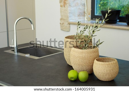 Kitchen decoration with wooden baskets and apples
