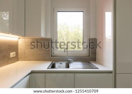 Kitchen detail, sink overlooking nature. Nobody inside