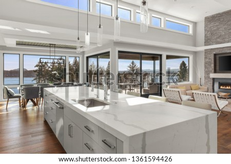 Kitchen, Dining, and Living Room in New Contemporary Luxury Home. Features Stunning Views. Large Waterfall Island in Kitchen Overlooks Open Concept Dining and Living Room.  #1361594426