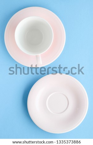 Kitchen, dishware and drinks concept - Empty cup and saucer on blue background, flatlay #1335373886