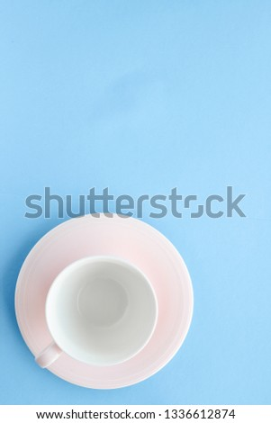 Kitchen, dishware and drinks concept - Empty cup and saucer on blue background, flatlay #1336612874