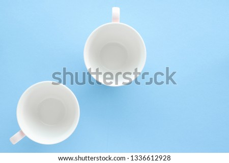 Kitchen, dishware and drinks concept - Empty cup and saucer on blue background, flatlay #1336612928