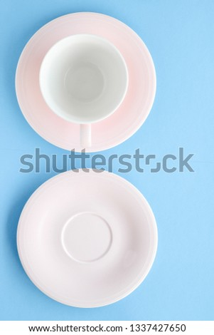 Kitchen, dishware and drinks concept - Empty cup and saucer on blue background, flatlay #1337427650