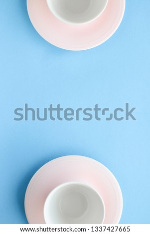Kitchen, dishware and drinks concept - Empty cup and saucer on blue background, flatlay #1337427665