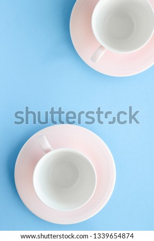 Kitchen, dishware and drinks concept - Empty cup and saucer on blue background, flatlay #1339654874